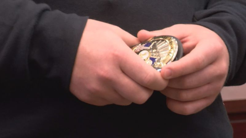 Officer Michael Stogdale holds his badge at the Rockbridge County Courthouse after being sworn...