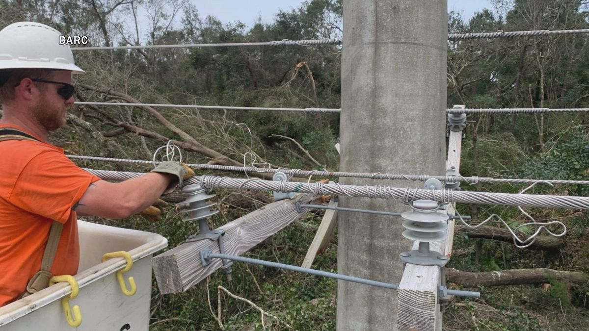 A BARC lineman works to bring back electrical service in Alabama following Hurricane Sally