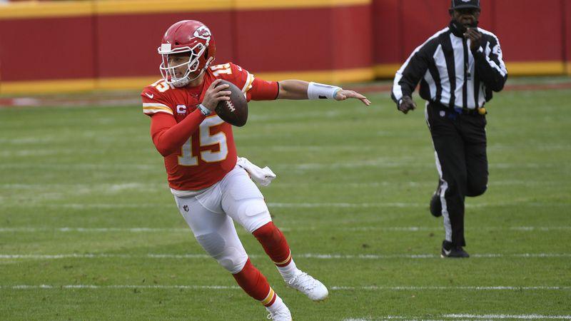 Kansas City Chiefs quarterback Patrick Mahomes scrambles up field during the first half of an...