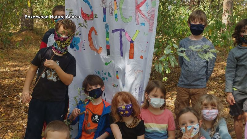 Kids in Boxerwood's PALS program stand by their Stick City banner.