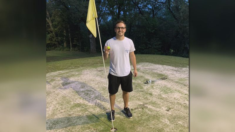 Kyle Clifford poses with his golf ball after making a hole-in-one on the 7th hole at Brookside...