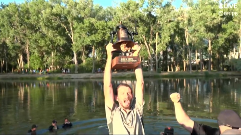 James Conrad raises the trophy after winning the 2021 PDGA Professional Disc Golf World...