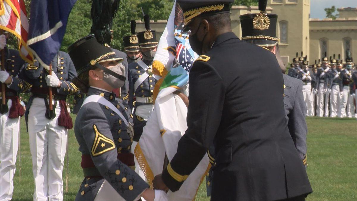 New VMI Cadet Regimental Commander Kasey Meredith accepts the VMI flag as a symbol of her...