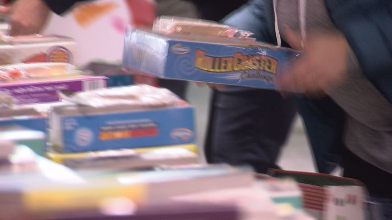 Volunteers pack toys as part of the week-long packing for the Rockbridge Christmas Basket program