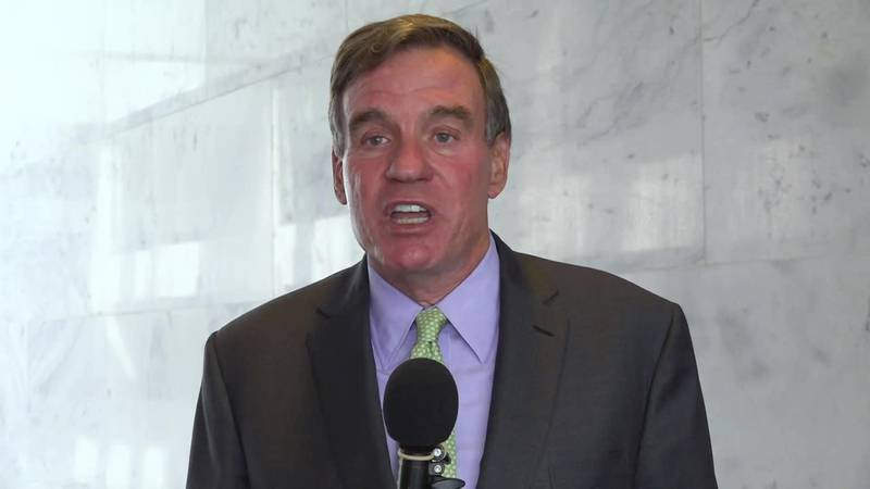 Sen. Mark Warner does an interview on Capitol Hill from outside his office.