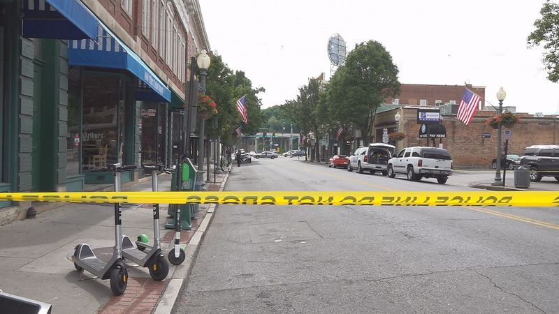 Caution tape went up near Market Street in downtown Roanoke after a shooting took place.