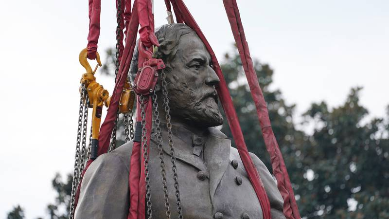 Lifting straps surround the Lee statue as crews remove one of the country's largest remaining...