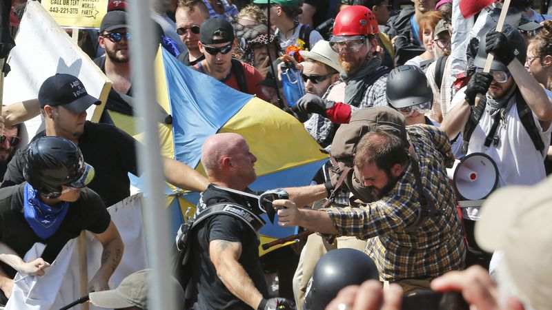FILE - In this Aug. 12, 2017 file photo, white nationalist demonstrators clash with...