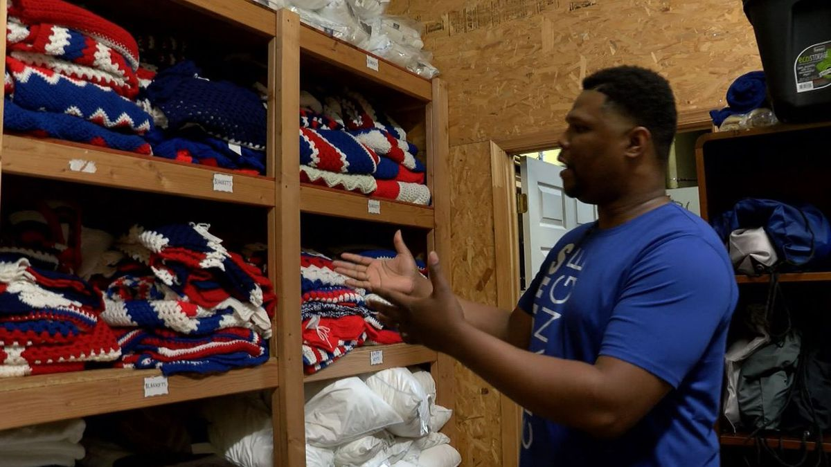 Pastor Jay Patrick shows blankets and other supplies at Liberation Veterans Services. (Source: NBC12)