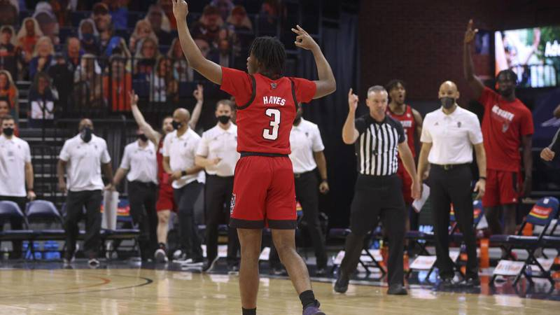 Cam Hayes celebrates NC State's win over Virginia Wednesday night