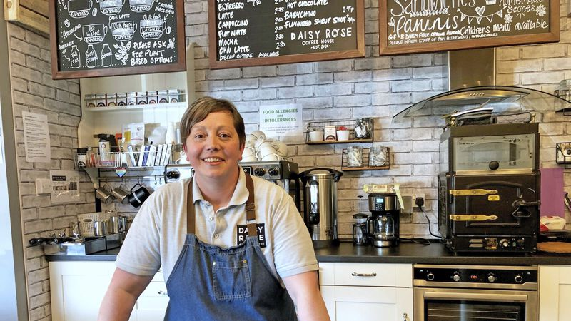 Caroline Atkinson, owner of the Rose Coffee House poses for a photo as she prepares to reopen,...