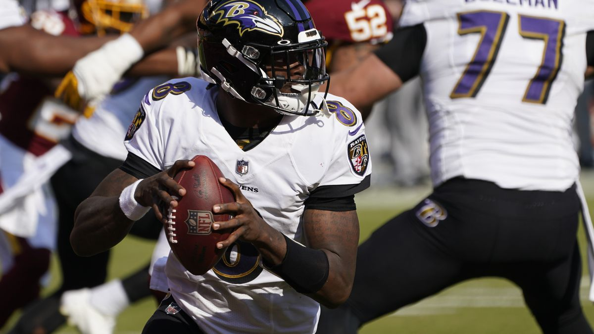 Baltimore Ravens quarterback Lamar Jackson (8) works in the pocket against the Washington Football Team during the second half of an NFL football game, Sunday, Oct. 4, 2020, in Landover, Md. (AP Photo/Steve Helber)