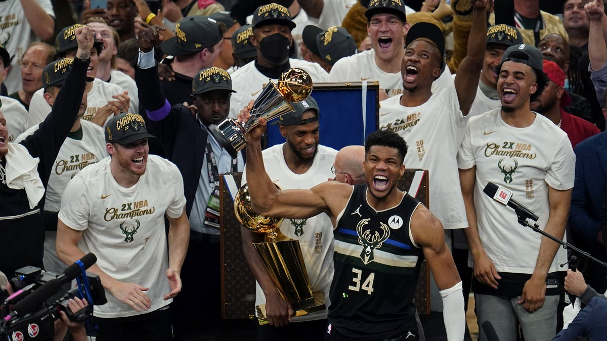 Milwaukee Bucks forward Giannis Antetokounmpo (34) reacts with the championship trophy after...