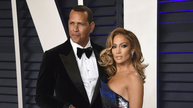 FILE - Alex Rodriguez, left, and Jennifer Lopez arrive at the Vanity Fair Oscar Party in...