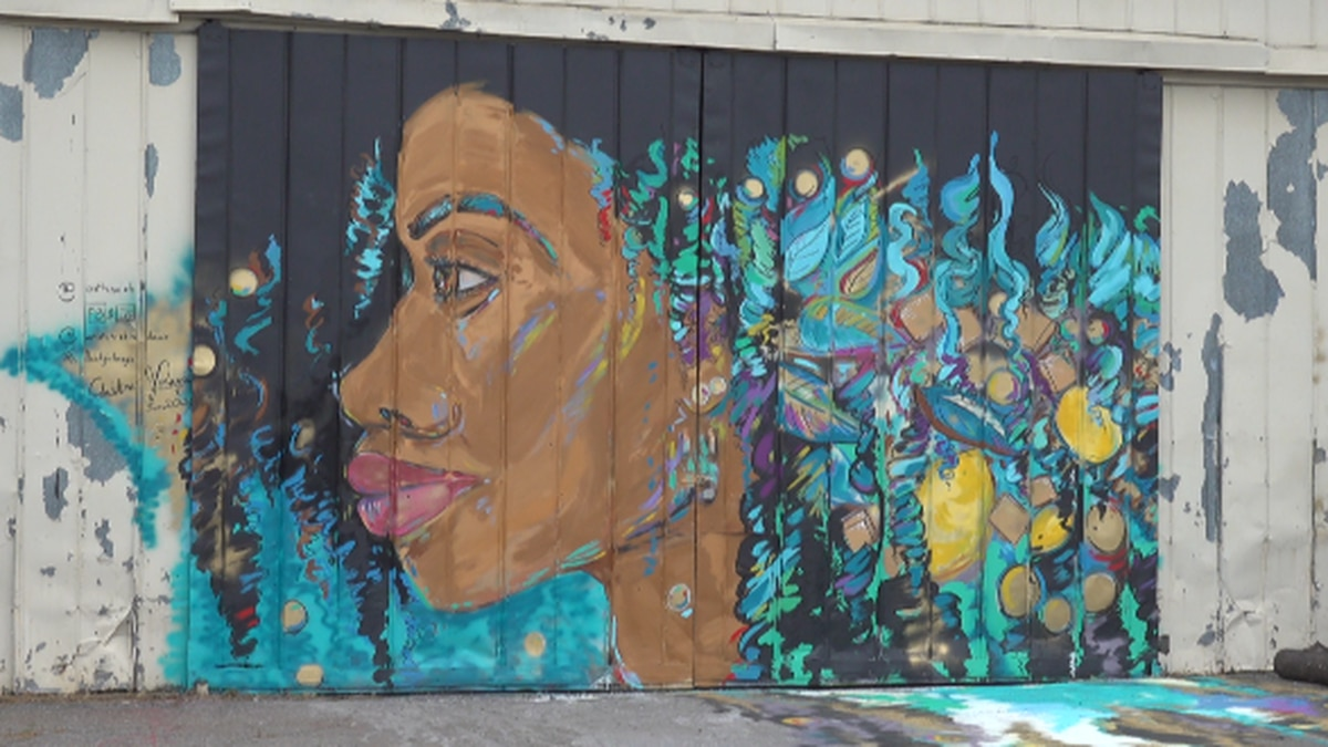 Davis says the mural is a reflection of herself. WDBJ7 photo.