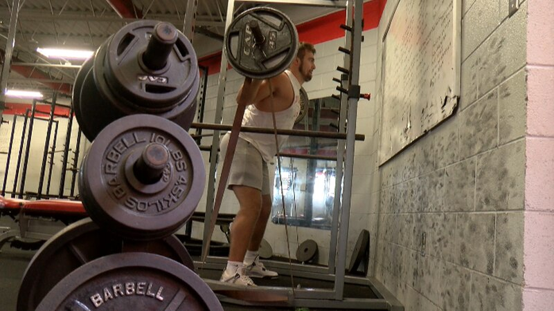 Lord Botetourt offensive tackle Gunner Givens working out in the Cavaliers' weight room.