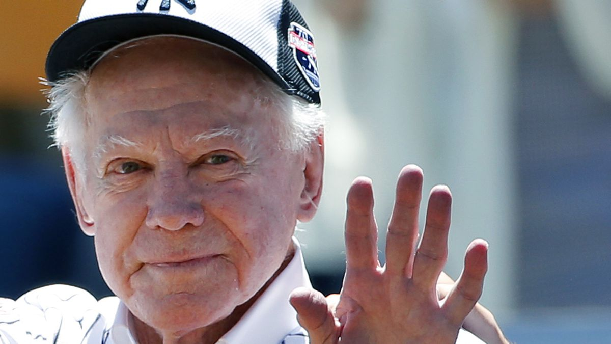 Former New York Yankees pitcher Whitey Ford waves to fans from outside the dugout at the Yankees' annual Old Timers Day baseball game, Sunday, June 12, 2016, in New York.