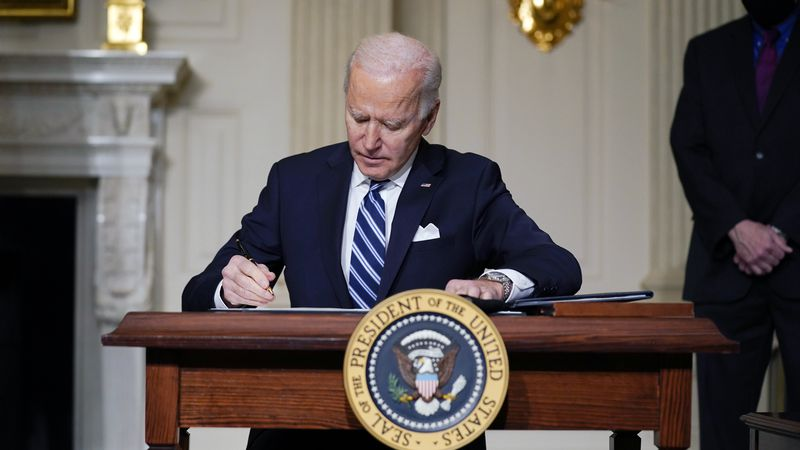 FILE - In this Jan. 27, 2021 file photo, President Joe Biden signs an executive order on...