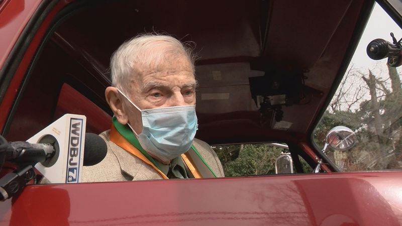 Allen Hickman prepares to set out on a 103rd birthday parade in an antique fire engine.