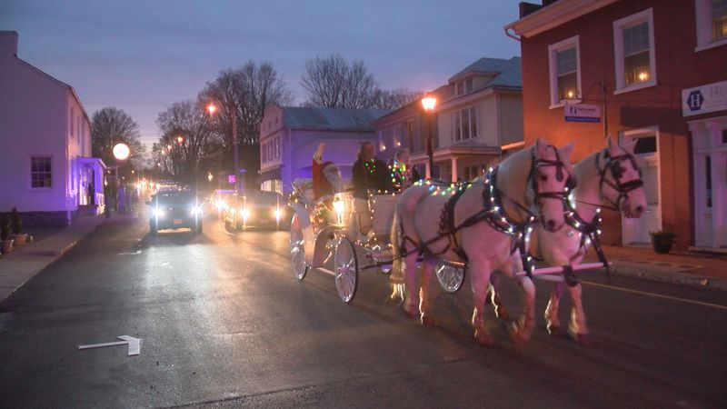 Santa and Mrs. Claus ride down Lexington, Va., Main Street for a virtual candlelight procession.