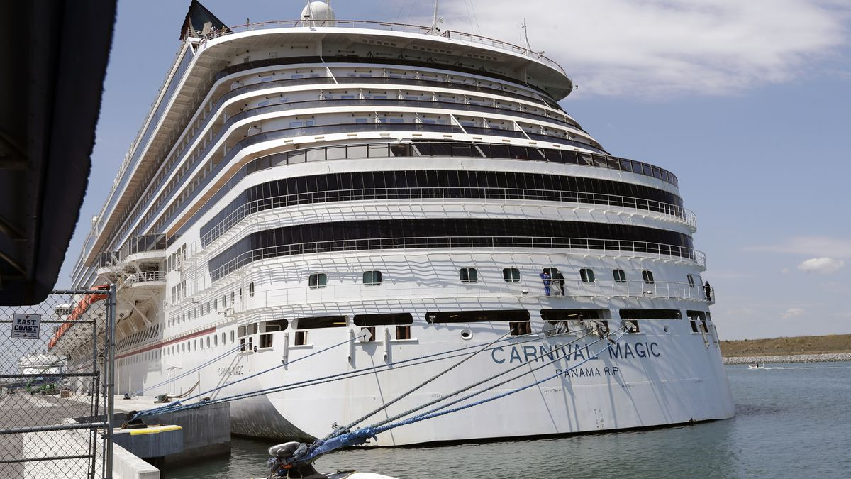 FILE - In this Saturday, April 4, 2020, file photo, Carnival cruise line ship Carnival Magic is docked at Port Canaveral, in Cape Canaveral, Fla. Carnival Cruise Line is canceling most U.S. sailings through the end of this year, the latest sign that the cruise industry's recovery from the coronavirus pandemic could still be many months away. The company said Thursday, Oct. 1, 2020, it is canceling sailings from all ports except its home ports of Miami and Port Canaveral, Florida.