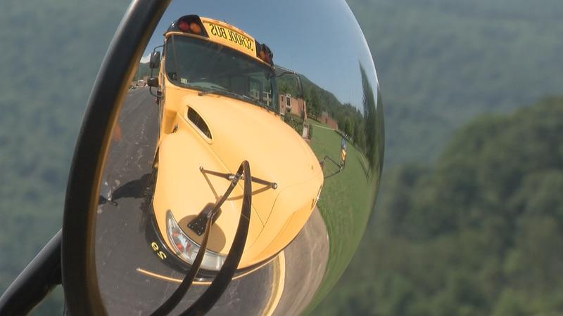 A school bus outside Alleghany High School awaits students.