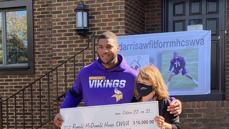 Christian Darrisaw presents check to Ronald McDonald House of Southwest Virginia
