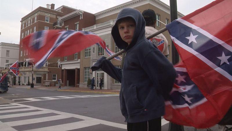Protestors hold Confederate flags on Main Street in Lexington, Va.