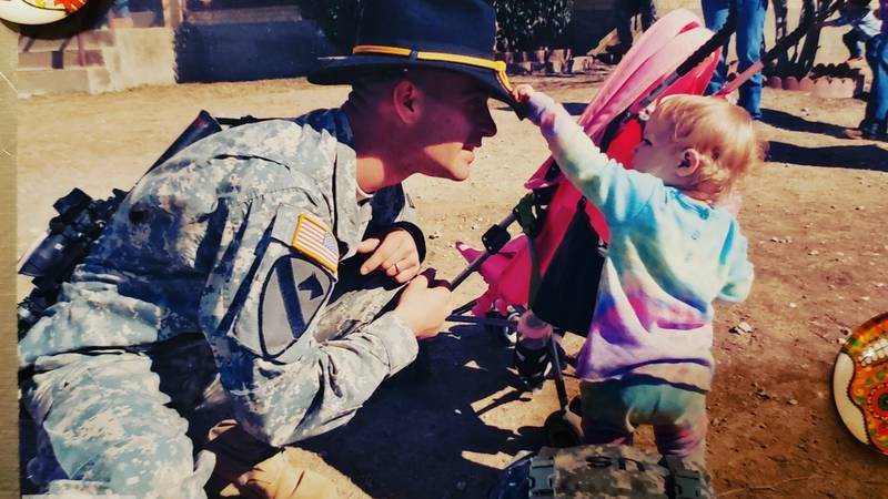 Andrew Kintgen visits his daughter after deployment in Iraq