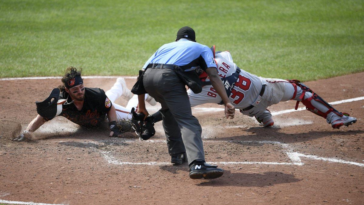 Baltimore Orioles' Ryan McKenna, left, is safe at home against Washington Nationals catcher...
