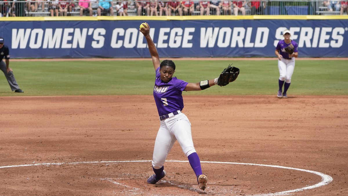 James Madison's Odicci Alexander pitches in the first inning of an NCAA Women's College World...