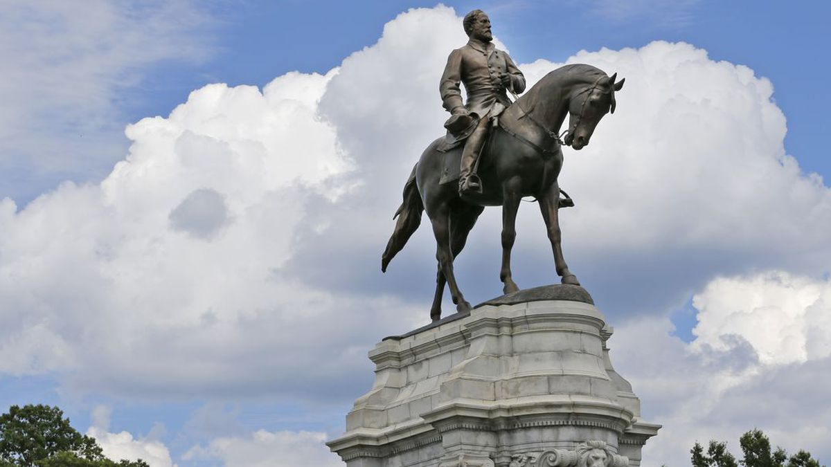 FILE - This Tuesday June 27, 2017 file photo shows the statue of Confederate General Robert E. Lee that stands in the middle of a traffic circle on Monument Avenue in Richmond, Va. Virginia Gov. Ralph Northam is expected to announce plans Thursday, June 4, 2020 for the removal of an iconic statue of Confederate Gen. Robert E. Lee from Richmond's prominent Monument Avenue. (AP Photo/Steve Helber, file) (Source: Steve Helber)