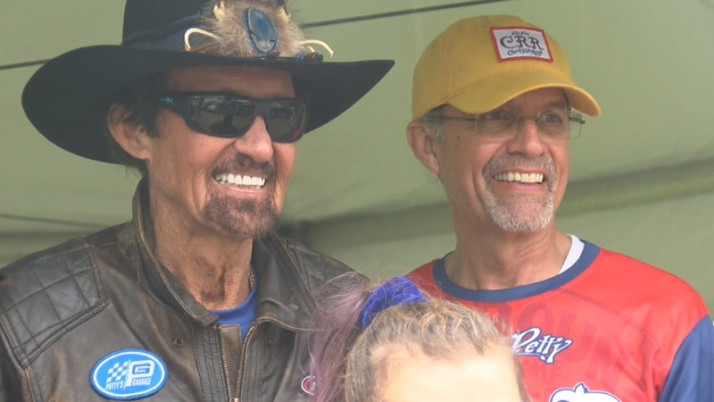 Kyle Petty (right) poses for photo op with father, Richard, at Charity Ride Revival in Bedford,...