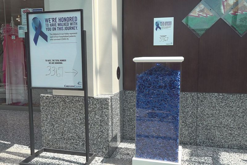 Carilion put up this blue ribbon display in their Roanoke Memorial lobby for COVID-19 survivors.