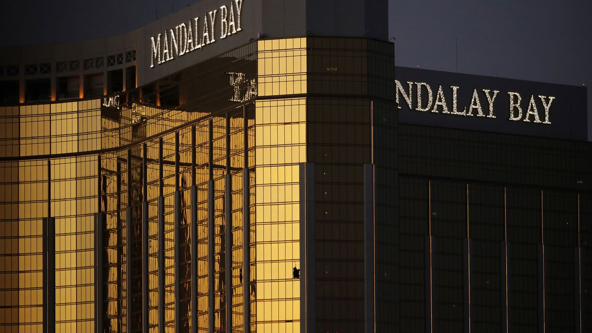 FILE - In this Oct. 3, 2017, file photo, windows are broken at the Mandalay Bay resort and casino in Las Vegas, the room from where Stephen Craig Paddock fired on a nearby music festival, killing 58 and injuring others, on Oct. 1, 2017. A judge in Nevada has approved a total of $800 million in payouts from casino company MGM Resorts International and its insurers to more than 4,400 relatives and victims of the Las Vegas Strip shooting that was the deadliest in recent U.S. history.