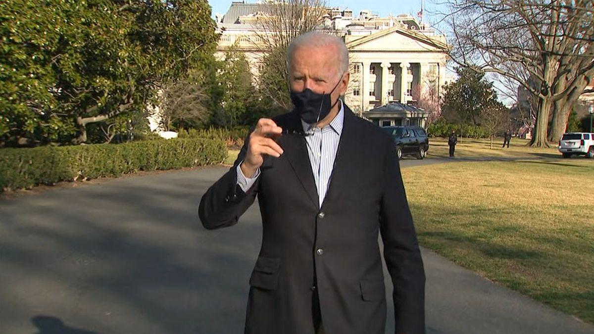 President Joe Biden talks to pool reporters at the White House on Sunday.