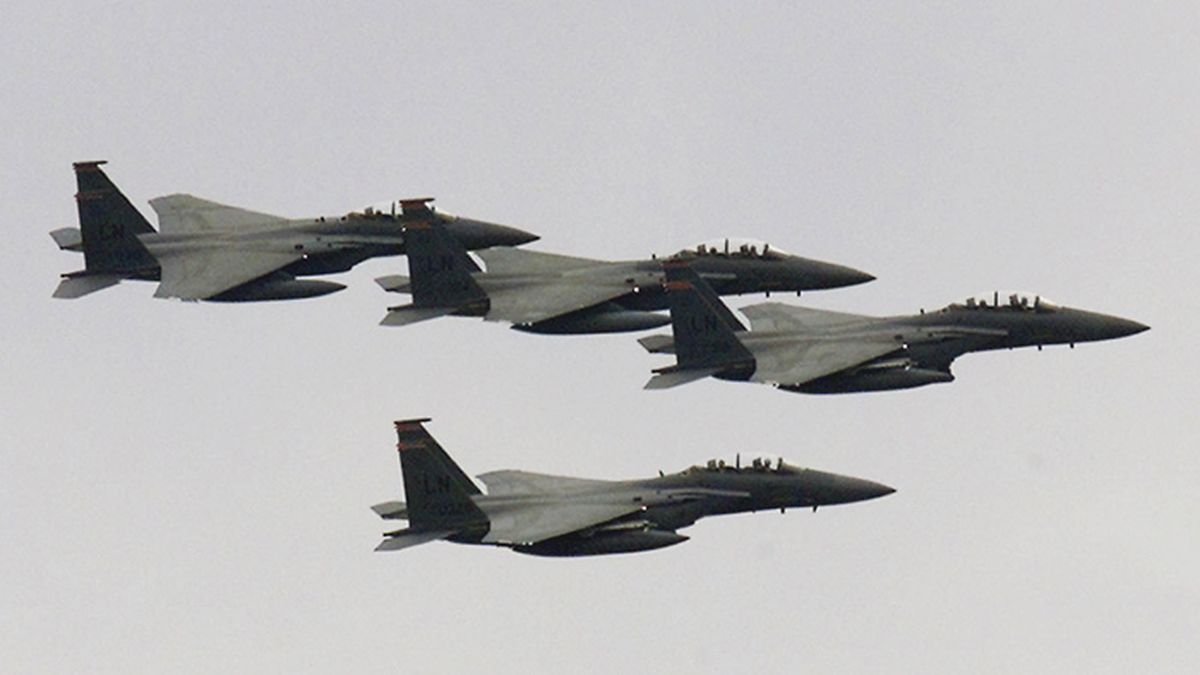 U.S. Air Force F-15's from 194 squadron based at RAF Lakenheath fly past during the rededication of the American Air Museum at the Duxford Imperial War Museum, England in this Sept. 27, 2002 file photo. A F-15 from the base crashed into the North Sea on Monday morning. (AP Photo/Max Nash/file)