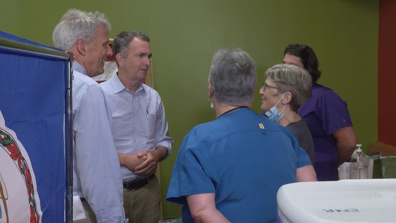 Gov. Ralph Northam (2nd from left) meets nurses at a vaccine clinic in White's Travel Center.