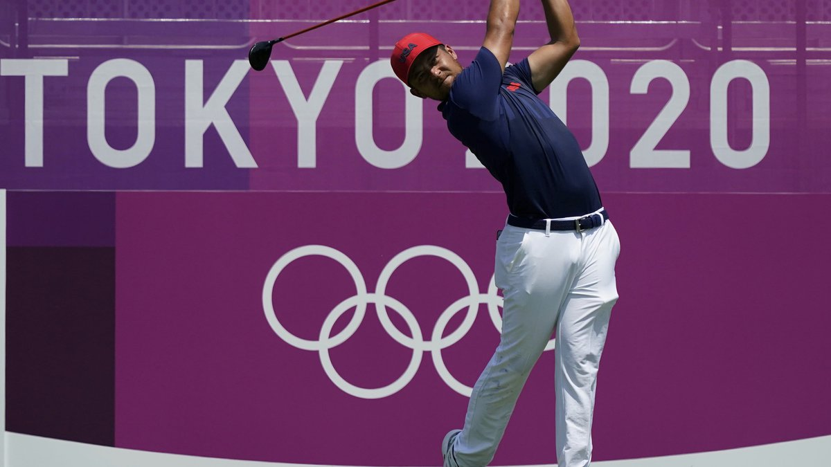 Xander Schauffele of United States hits a tee shot on the first hole during the final round of...