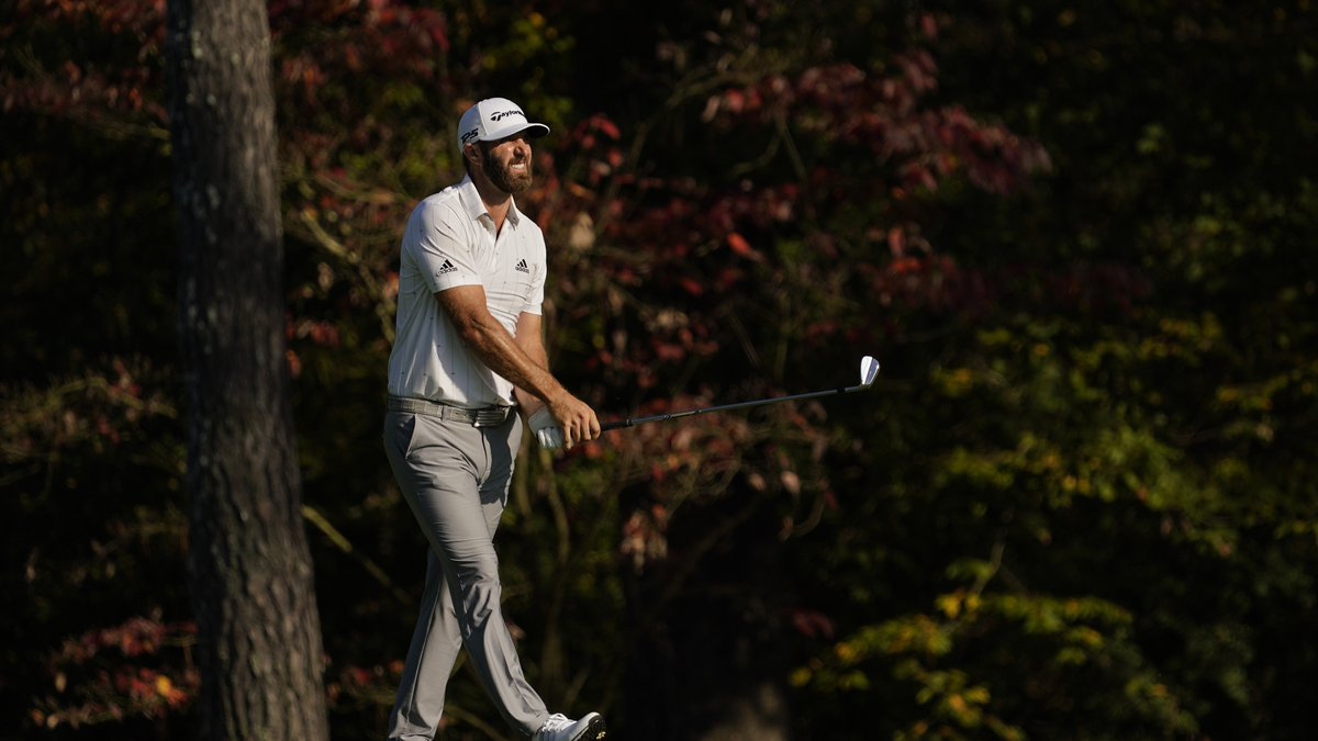 Dustin Johnson watches his second shot on the 11th hole during the third round of the Masters...