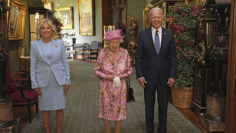 This photo shows Britain's Queen Elizabeth II with U.S. President Joe Biden and first lady Jill...