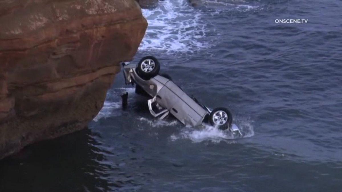 A San Diego man is in police custody and his twin toddlers are in the hospital after he drove off a cliff in what police say was a suicide attempt. (Source: OnScene.TV via CNN)