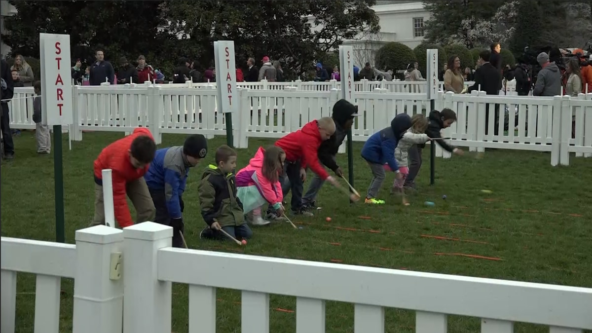 Kids of all ages roll eggs on the White House lawn. (Gray: DC)