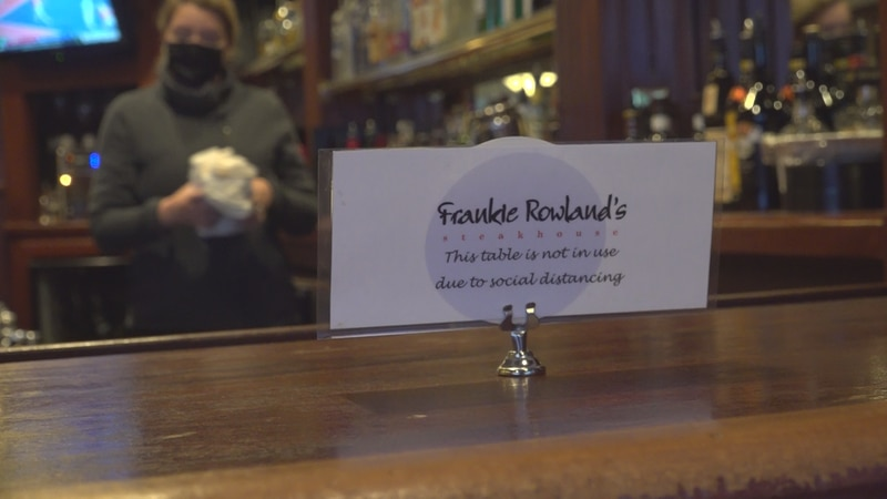 Bartenders at Frankie Rowland's in downtown Roanoke clean ahead of the dinner rush.
