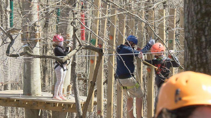 Families enjoy the Treetop Quest adventure course.