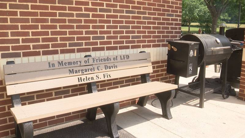 A bench memorializing two benefactors to the Lexington, Va., Fire Department sits in a place...