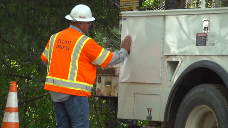 A man works to help restore power Wednesday.