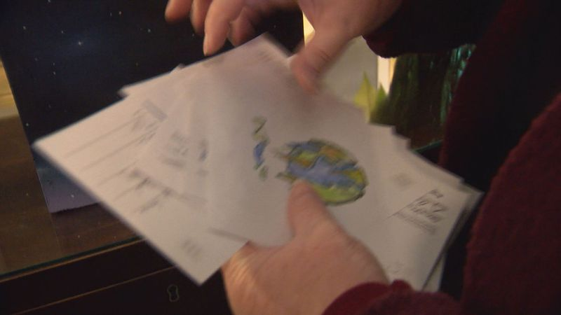 Some of the postcards left by kids in a collection box at The Omni Homestead to be sent into...
