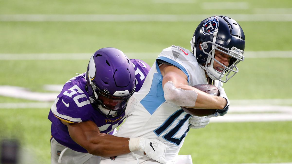 Tennessee Titans wide receiver Adam Humphries is tackled by Minnesota Vikings linebacker Eric Wilson (50) during the second half of an NFL football game, Sunday, Sept. 27, 2020, in Minneapolis.