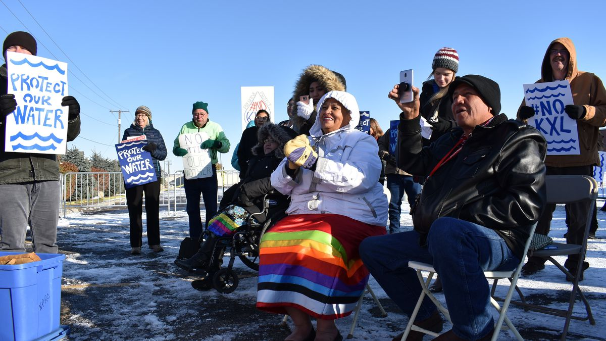 In this Oct. 29, 2019, file photo, opponents of the Keystone XL oil pipeline from Canada demonstrate in sub-freezing temperatures in Billings, Mont.